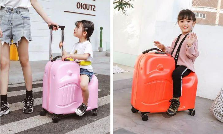 çocukların bindiği bavul